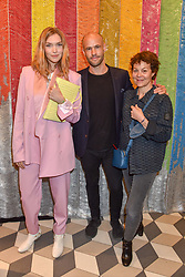 Arizona Muse, Cameron Saul and Helen McCrory at a cocktail supper hosted by BOTTLETOP co-founders Cameron Saul & Oliver Wayman, along with Arizona Muse, Richard Curtis & Livia Firth to launch the #TOGETHERBAND campaign at The Quadrant Arcade on April 24, 2019 in London, England.<br /> <br /> ***For fees please contact us prior to publication***