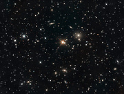 Several galaxies in the constallation Pisces. The bright star in the center is SAO 54647 (mag. 7,6).  The brightest galaxy to the right of the central star is NGC 507 of mag. 11,3.