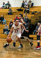 Laconia's Kelby Brooker charges down court with St Thomas Aquinas' Diego Garcia during NHIAA Division III basketball Friday evening.  (Karen Bobotas/for the Laconia Daily Sun)