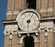 Clock detail from the entrance/courtyard to the Capitolini museums, in Rome, Italy. The museums themselves are contained within 3 palazzi as per designs by Michelangelo Buonarroti in 1536, they were then built over a 400 year period.