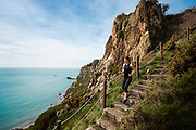 Woman enjoying an active healthy lifestyle in Jersey Channel Islands, running on the south coast cliff paths