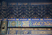 "Roof decoration detail at Yonghe Temple, also known as the ""Palace of Peace and Harmony Lama Temple"", the ""Yonghe Lamasery"", or - popularly - the ""Lama Temple"" is a temple and monastery of the Geluk School of Tibetan Buddhism located in the northeastern part of Beijing, China. It is one of the largest and most important Tibetan Buddhist monasteries in the world. The building and the artworks of the temple is a combination of Han Chinese and Tibetan styles."