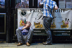 © Licensed to London News Pictures . 15/06/2014 . Manchester , UK . A man sits on the pavement in front of a pub . People on a night out in Manchester City Centre overnight , following England's defeat to Italy in the World Cup . Photo credit : Joel Goodman/LNP