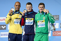 July 26, 2017 - Budapest, Hungary - (L-R) Brazil's Joao Gomes Junior (silver) Great Britain's Adam Peaty (gold) and South Africa's Cameron van der Burgh (bronze) pose during the podium ceremony for the men's 50m breaststroke final during the swimming competition at the 2017 FINA World Championships in Budapest, on July 26, 2017. (Credit Image: © Foto Olimpik/NurPhoto via ZUMA Press)