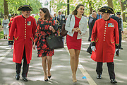 Chelsea pensioners arrive with friends - The Combined Cavalry OCA Parade, Hyde Park. More than two thousand cavalrymen march in a mixture of uniforms or suits with bowler hats (for officers only) and furled umbrellas creating a quintessentially British scene. It is the 93rd Annual Parade and Service of The Combined Cavalry Old Comrades Association at the Cavalry Memorial adjacent and the Bandstand in Hyde Park. Field Marshal Baron Guthrie GCB, LVO, OBE, DL Colonel The Life Guards and Gold Stick took the salute at the march past for both serving and former soldiers of all the Regiments of Regular Cavalry and many Yeomanry Regiments.