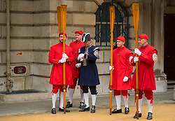 Members of the Company of Watermen and Lightermen wait to take part in the Lord Mayor's parade in the City of London.