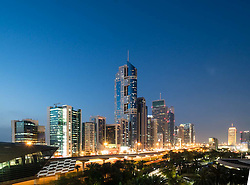Dusk view of skyline of skyscrapers along Sheikh Zayed Road in Dubai United Arab Emirates