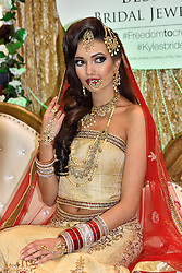 © Licensed to London News Pictures. 27/03/2016. A models poses wearing jewellery at a stand at the Asian Bride Live Wedding Show featuring fashion, beauty and services for brides to be. London, UK. Photo credit: Ray Tang/LNP