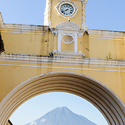The Volcán de Agua can be seen under the arch at the Santa Catalina in Antigua, Guatemala.