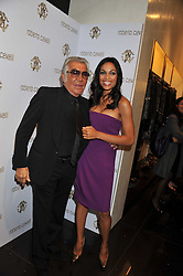 ROBERTO CAVALLI and ROSARIO DAWSON at a party hosted by Roberto Cavalli to celebrate his new Boutique's opening at 22 Sloane Street, London followed by a party at Battersea Power Station, London SW8 on 17th September 2011.