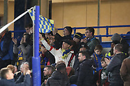 AFC Wimbledon fan waving flag during the EFL Trophy match between U21 Chelsea and AFC Wimbledon at Stamford Bridge, London, England on 4 December 2018.