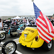 A customized bike using the tail end of a yellow VW Beetle participating in the annual Rolling Thunder motorcycle rally through downtown Washington DC on May 29, 2011. This shot was taken as the riders were leaving the staging area in the Pentagon's north parking lot, where thousands of bikes and riders had gathered.