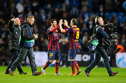 Barcelona Midfielder Lionel Messi (ARG) and Midfielder Andres Iniesta (ESP) high five after their sides 0-2 win - Photo mandatory by-line: Rogan Thomson/JMP - Tel: 07966 386802 - 18/02/2014 - SPORT - FOOTBALL - Etihad Stadium, Manchester - Manchester City v Barcelona - UEFA Champions League, Round of 16, First leg.