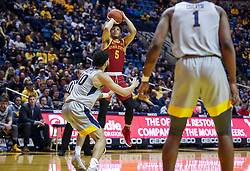 Mar 6, 2019; Morgantown, WV, USA; Iowa State Cyclones guard Lindell Wigginton (5) shoots a jumper during the first half against the West Virginia Mountaineers at WVU Coliseum. Mandatory Credit: Ben Queen-USA TODAY Sports