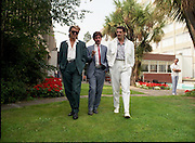 """Sade and Tony Hadley Interviews.  P92..1984.21.08.1984..08.21.1984..21st August 1984..As part of his interview sessions for """"Video File"""" for R.T.E., Marty Whelan interviewed international music stars. The interviews were held in the R.T.E.,studios and at various hotels throughout the city...Image shows R.T.E.,personality Marty Whelan (centre) with Spandau Ballet members Gary Kemp and Tony Hadley."""
