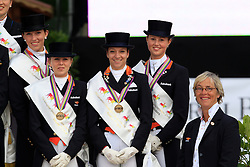 Podium Young Riders team The Netherlands<br /> 3. NED : Van Lanen Michelle, Houtvast Dani'lle, Kooijman Stephanie, Krooswijk Angela, chef d'equipe Bartels Tineke<br /> FEI European Dressage Championship Juniors - Young Riders - Bern 2012 <br /> © Hippo Foto - Leanjo de Koster