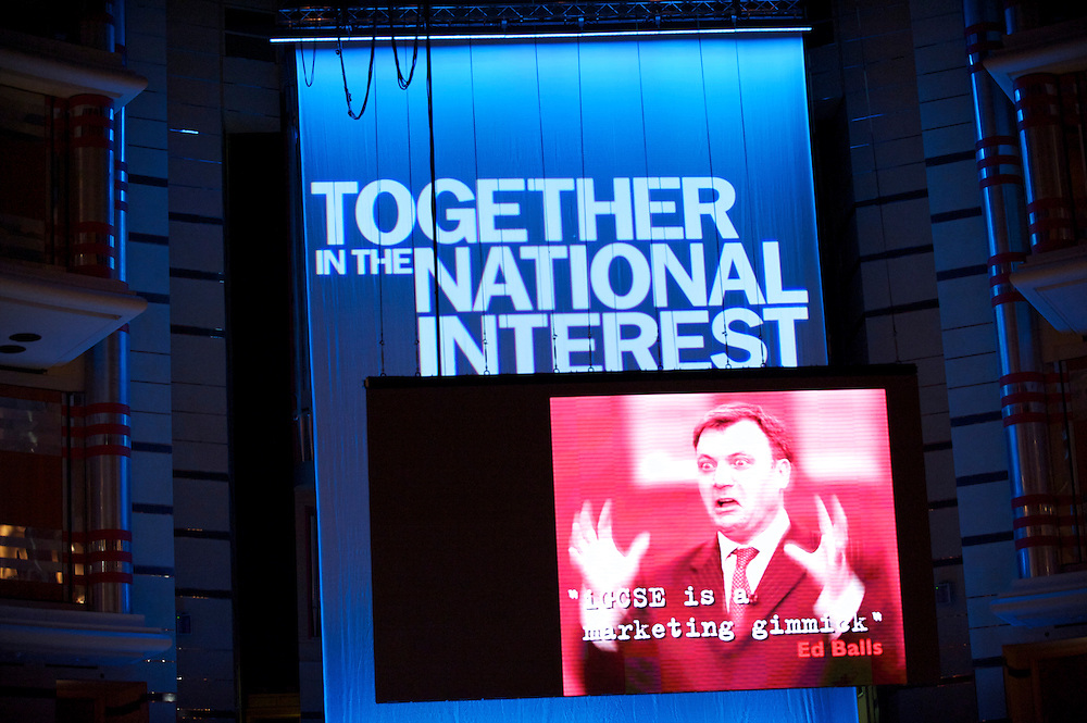 A multimedia display is broadcast high above on a giant screen mocking Labour MP Ed Balls during a presentation by the Secretary of Education Michael Gove on the third, and penultimate, day of the Conservatives Party Conference at the ICC, Birmingham, England on October 5, 2010.  This is the first conference since the government coalition with the Liberal Democrats.