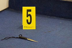 © Licensed to London News Pictures. 12/03/2020. London, UK. An evidence identification marker sits next to a knife at a crime scene after police were called to reports of a group of youths fighting at Mansion Court in Walthamstow, four teenagers were taken to hospital with stab and slash injuries. Seven arrests were made. Photo credit: Peter Manning/LNP