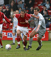 Photo: Dave Linney.<br />Walsall v Bradford City. Coca Cola League 1. 25/03/2006.<br />Walsall's (L) pushes his way past  David Wetherall