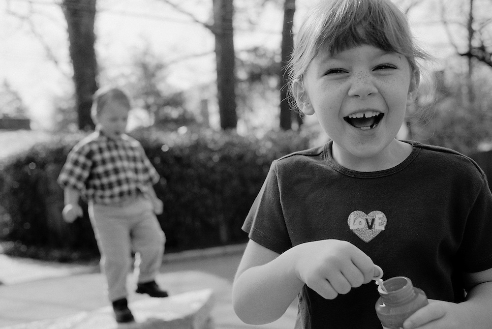 black and white photograph of kids playing