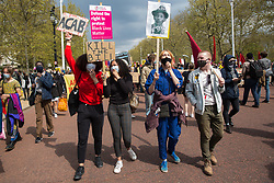 London, UK. 1st May, 2021. Thousands of people march along the Mall holding placards and signs during a Kill The Bill demonstration as part of a National Day of Action to mark International Workers Day. Nationwide protests have been organised against the Police, Crime, Sentencing and Courts Bill 2021, which would grant the police a range of new discretionary powers to shut down protests.