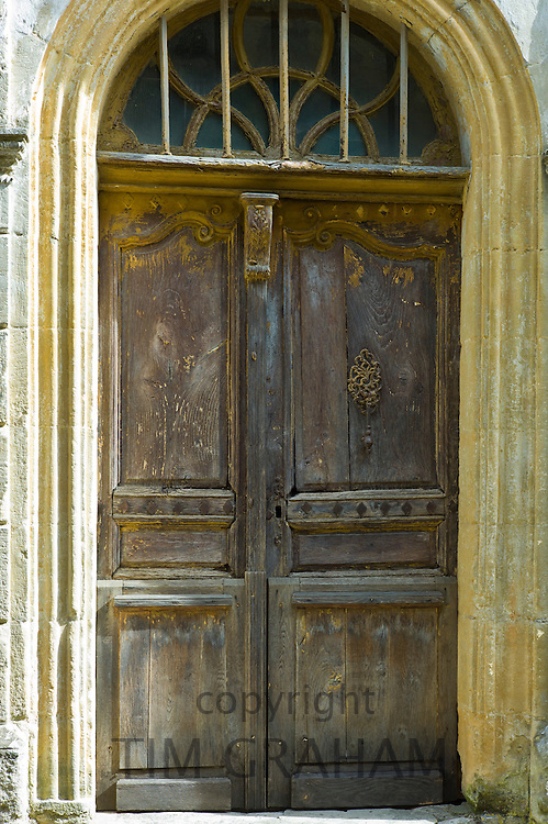Traditional French doorway in quaint town of Castelmoron d'Albret in Bordeaux region, Gironde, France