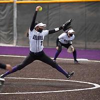 Lakisha Shorty (7) pitches for the Miyamura Patriots against the Aztec Tigers Wednesday in Gallup.