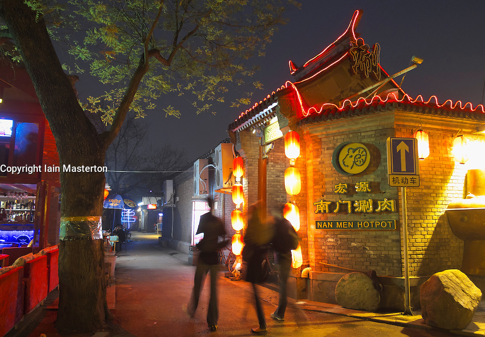 Restaurant at night on historic hutong in new Houhai entertainment district in Beijing China