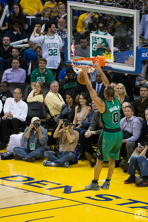 Boston Celtics guard Avery Bradley (0) dunks the ball on during a fast break against the Golden State Warriors at Oracle Arena in Oakland, Calif., on March 8, 2017. (Stan Olszewski/Special to S.F. Examiner)