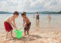 Gabriel Fuller and Grant Aguilar play at the shore of Lake Waukewan Beach Friday afternoon.  (Karen Bobotas/for the Laconia Daily Sun)