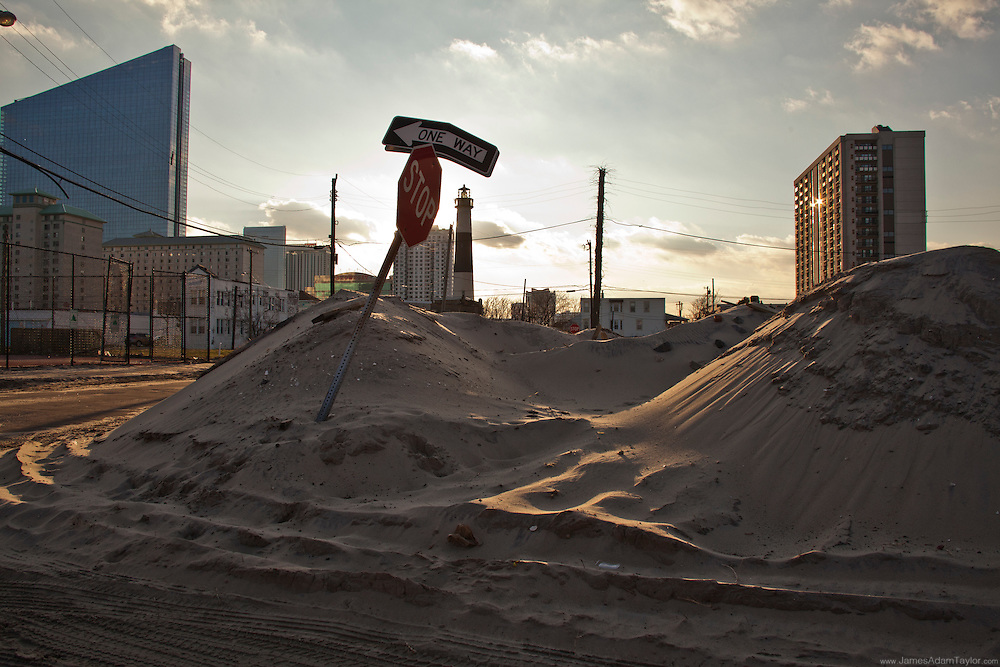 Sand piled high as though by snow plow, northern Atlantic City