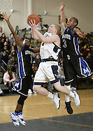 Newburgh Free Academy's Steven Spencer, center, takes a shot between Middletown's Kevin Dorelus, left, and Spencer Bonneau during a game in Newburgh on Jan. 18, 2008.