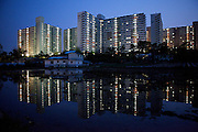 Anseong/South Korea, Republic of Korea, KOR,27.04.2009: High-rise buildings mirrored in a rice field located in Anseong about 80 Km from Seoul.