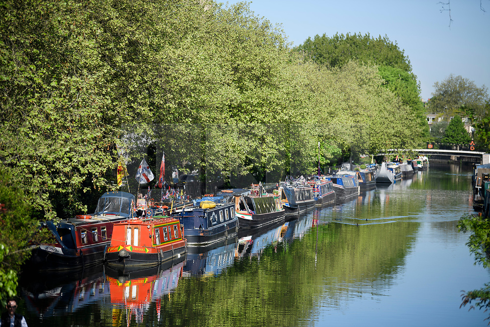 © Licensed to London News Pictures. 05/05/2018. London, UK. Colourful boats along the Grand Union canal as the Canalway Cavalcade festival takes place in Little Venice, West London on Saturday,  May 5th 2018. Inland Waterways Association's annual gathering of canal boats brings around 130 decorated boats together in Little Venice's canals on May bank holiday weekend. Photo credit: Ben Cawthra/LNP
