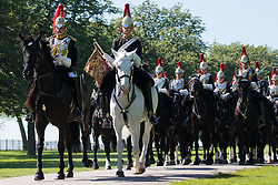 Windsor, UK. 9th June, 2021. The Household Cavalry Mounted Regiment proceeds along the Long Walk in Windsor Great Park for a dress rehearsal at Windsor Castle for Trooping the Colour. A socially distanced and scaled down Trooping the Colour ceremony to mark the Queen's birthday will take place at Windsor Castle on 12th June incorporating many of the elements from the annual ceremonial parade on Horse Guards, with F Company Scots Guards Trooping the Colour of the 2nd Battalion Scots Guards in the Castle Quadrangle.