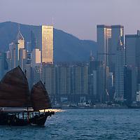 China, Hong Kong, Sailing junk in Hong Kong Harbour at sunset