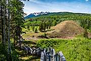 """Gitwangak Battle Hill is a National Historic Site of Canada, in Kitwanga village (or Gitwangax, """"people of the place of rabbits"""" in the Gitxsan language), British Columbia. Battle Hill (Daa'ootsip) was a fortified village occupied in the late 1700s and early 1800s by the Gitwangak, a local First Nations people. Kitwanga is sited where the Kitwanga River flows into the Skeena River, at the crossroads of the old """"grease trail"""" trade in eulachon (candlefish) oil, a staple among tribes of the Coast and Interior. Kitwanga is at the southern end of the scenic Stewart–Cassiar Highway (Highway 37, aka Dease Lake Highway or Stikine Highway, the northwesternmost highway in BC), just 4 km north of the Yellowhead Highway (Hwy 16). A long-standing village before contact, Kitwanga is within Gitwangak Indian Reserve No. 1."""