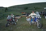 Jim Hyde (left) and Kevan Harder took a chain saw out on their bikes and cut firewood for the campfire.