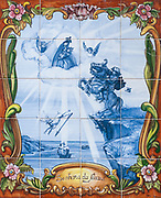 Christian Religious art in hand painted ceramic tiles. Sinhora da Nazare (Our Lady of Nazareth) Photographed in Nazare, Portugal