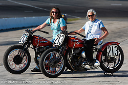 Gloria Struck on Steve Coe's flathead racer with daughter Lori DiSilva (on another one of Steve's bikes) on the New Smyrna Speedway after the Sons of Speed Race during Daytona Bike Week. New Smyrna Beach, FL. USA. Saturday March 17, 2018. Photography ©2018 Michael Lichter.