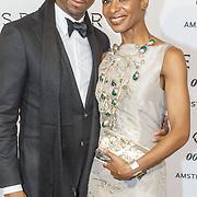 NLD/Amsterdam/20151028 - Premiere James Bondfilm Spectre, Sylvana Simons met haar neef Regillio Denswil