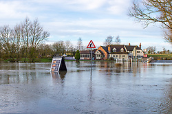 © Licensed to London News Pictures. 22/12/2019. Aylesbury, UK. Mill Lane in the village of Shabbington is submerged after the River Thame burst its banks during heavy rain across Buckinghamshire. Photo credit: Peter Manning/LNP