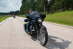 Jack McIntyre on the Legends Ride - riding from Deadwood to the Buffalo Chip during the 78th annual Sturgis Motorcycle Rally. Sturgis, SD. USA. Monday August 6, 2018. Photography ©2018 Michael Lichter.