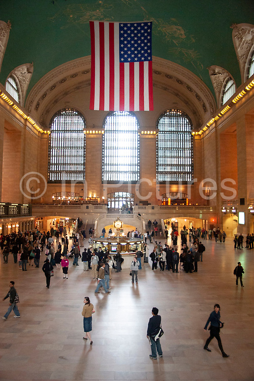 Main terminal hall at Grand Central Station with the Stars and Stripes US flag hanging on 19th May 2007 in New York City, United States.