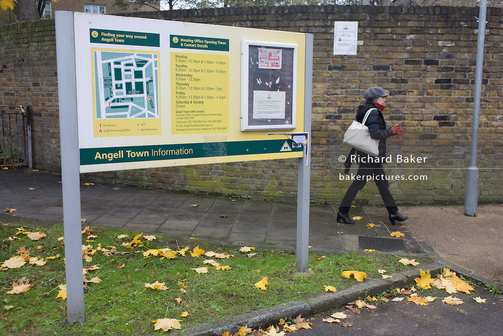Angell estate information sign. Guarded by police officers is the address in Peckford Place, on the Angell estate in south London, identified as the location where - including another location(s) - three woman were held captive for a 30 year period by two others, said to be in bad conditions. A 30-year-old British woman, a 57-year-old Irish woman and a 69-year-old Malaysian woman are deeply traumatised and in the protection of the 'Freedom Charity' whom they first contacted about their enslavement. The couple accused of their captivity have been bailed.
