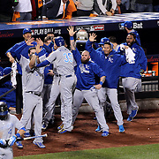Eric Hosmer, Kansas City Royals, is congratulated by team mates after leveling the scores in the ninth inning during the New York Mets Vs Kansas City Royals, Game 5 of the MLB World Series at Citi Field, Queens, New York. USA. 1st November 2015. Photo Tim Clayton