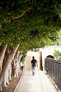 A man walks through the gardens of a church in the small, coastal town of Byblos in Lebanon