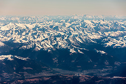 Majestic view of rocky mountains with snow against sky