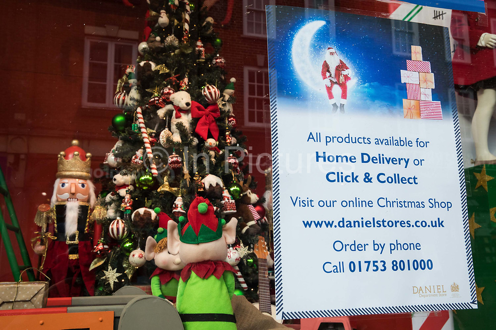 """A Christmas display in the window of Daniel department store is pictured during the second coronavirus lockdown on 9th November 2020 in Windsor, United Kingdom. Only retailers selling """"essential"""" goods and services are permitted to open to the public during the second lockdown but the department store is currently able to offer goods for home delivery or click and collect."""