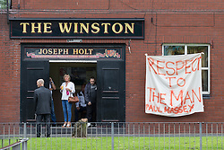 "© Licensed to London News Pictures . 28/08/2015 . Salford , UK . Tributes painted on a sheet outside The Winston pub on Churchill Way , near to St Paul's CE Church . The funeral of Paul Massey at St Paul's CE Church in Salford . Massey , known as Salford's "" Mr Big "" , was shot dead at his home in Salford last month . Photo credit : Joel Goodman/LNP"